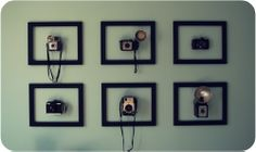 vintage camera display- kind of cool, but if they actually worked, I'd be taking them down and using them.