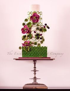 A 4-tier wedding cake as featured in the December 2014 issue of DIY Weddings Magazine.   This creation was inspired by an image on an Art Nouveau brooch which was based on the colours that were provided to be  A huge thank you to Candace Chand from Beau Petit Cupcakes for this amazing opportunity.