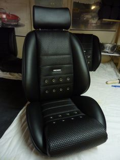 'Monte Carlo' seat in a custom leatherette basket weave with grommets and Recaro script. Classic Car Seats by GTS Classics.