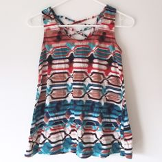 aztec inspired trapeze tank. Xhilaration for Target trapeze tank.  printed bright patterned colors.  54% cotton, 46% rayon, super soft and flowy.  cross back fabric detail.  size s.  great condition! Xhilaration Tops Tank Tops