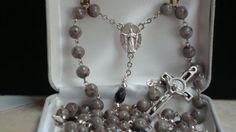 Gray Granite Flower Petal Beads ~ OF beads are Jet Blk Oval Faceted beads anchored by silver beads ~ Mary, Queen of Heaven - Ecce Homo Center ~ St Benedict Crucifix with Blk enamel inlay