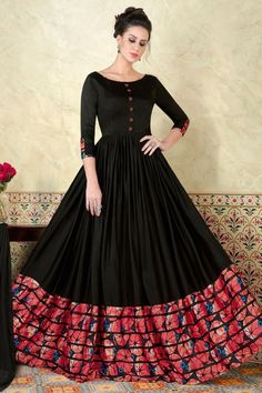 Be the sunshine of everybody's eyes dressed in this charming look black floor touch anarkali dress. The ethnic print work with a dress adds a sign of elegance statement with a look. Comes with matching bottom and dupatta Indian Designer Outfits, Indian Outfits, Designer Dresses, Black Anarkali, Anarkali Suits, Long Anarkali, Long Gown Dress, Saree Dress, Cotton Anarkali Dress