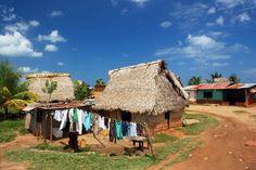 La Mosquitia, Honduras  Village passed on journey into La Mosquitia area