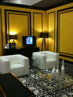 great room...those panels look like panels on a card... GREAT look for the movie room,with a green accent wall and this gold color YES