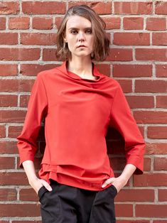 Porto's Ragtime Top features a mock neckline with a rounded seam and softly draped tucks. 3/4 length sleeves and a hemline that raises on one side with draped tucks, complete the design. Made from microfiber jet jersey from Italy- a washable, stretch fabric that is extremely comfortable and wrinkle resistant. Stretch Fabric, Hemline, Jet, Italy, Sleeves, Clothes, Tops, Design, Women