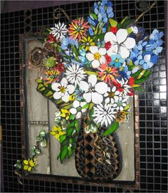 ways to recycle wine bottles | Dimensional mosaic of a vase of flowers | Mosaics