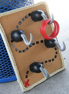 Game ideas for a pirate themed birthday party. This hook ring toss looks so fun.