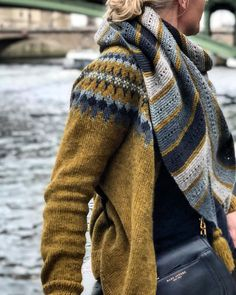 Knit cardigan in dark sand color with patterned yolk in blues and greys, with coordinating triangular knit scarf. Ravelry: Sirius by Camilla VadSirius is an elegant and soft sweater with a relaxed fit, round yoke and a pretty colorwork with 4 colors. Fair Isle Knitting, Free Knitting, Knitting Needles, Garter Stitch, Sweater Weather, Pulls, Knitting Projects, Look Fashion, Knitting Patterns