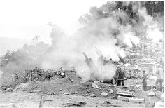 Smoke hangs over 105-mm howitzers as U.S. marines pour artillery shells into the A Shau Valley during Operation DEWEY CANYON I in Quang Tri Province in northern South Vietnam in 1969. The operation began on January 22, 1969; its objective was to deny Communist forces access to the populated coastal lowlands