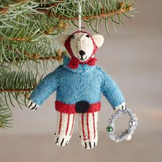 """GLEEFUL NORTH POLAR BEAR ORNAMENT--North Polar Bear is all ready for the holiday, with his scarf on and his wreath in hand. Felt/fiber fill/iron wire/glass bead eye. Imported. Catalog exclusive. 5""""W x 1""""D x 6""""H."""