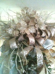 lovely silver and gold tree topper love the mix of silver gold and gold brocade ribbon just lovely design