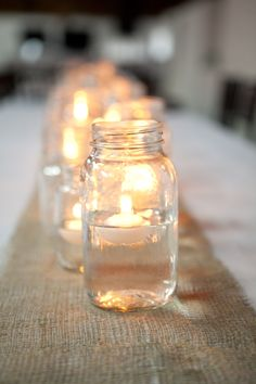Mason jars with floating candles create a nice ambiance for the tables at the reception. Or line the aisle with the same thing at your ceremony.
