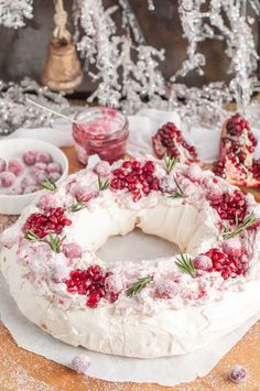 This holiday cranberry and pomegranate pavlova with marshmallowy inside topped with marbled mascarpone cream and berries is a festive paradise in your mouth