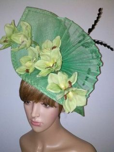 Lime Green sinamay, with orchids, rose, and feathers. by JANE RYDER #millinery #hats #HatAcademy