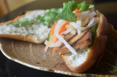 Lemongrass Tofu Banh Mi- a Vietnamese sandwich with tofu marinated in lemongrass, soy sauce, and.ginger then topped with picked carrots and daikon. Spread the bread with cilantro mayonnaise (vegan mayo preferred).