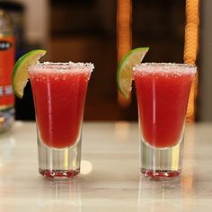 WATERMELON MARGARITA SHOTS 2 oz. (60ml) Tequila 1 oz. (30ml) Triple Sec 1 oz. (30ml) Lime Juice Frozen Watermelon Chunks Garnish: Salt Rim/Mini Lime Wedge PREPARATION 1. Rim edge of shot glass with lime juice and salt. Set aside. 2. Add frozen watermelon, tequila, triple sec and lime juice to a blender and combine until smooth. 3. Pour mix into shot glass and garnish with a mini lime wedge. DRINK RESPONSIBLY!