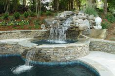 waterfall into hot tub into pool