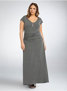 "<p>It's rare to find a maxi dress that can go from beach to ball, but hey, we're just that good. Stretchy-soft but clingy grey jersey knit sports a low scoop so you can flash a hint of skin. The shirred sides guarantee your hips will never lie.</p>  <p> </p>  <p><b>Model is 5'9.5"", size 1</b></p>  <ul> 	<li>Size 1 measures 58 1/2"" from shoulder</li> 	<li>Rayon/spandex</li> 	<li>Wash cold, dry flat</li> 	<li>Imported plus size dress</li> </ul>"