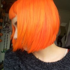 Bright orange bob #hair #bright #dyed After I get bored with my copper dreads, I'd like to add bangs and napalm orange dye to them.