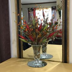 Turn your Fall arrangement into Christmas with a few ornaments!