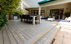 The client chose NewTechWood`s Antique colour Ultra Shield composite decking boards which suited the new colour of the house and the outdoor furniture but also complimented the brand new Tera Coat seamless floors that had just been installed internally.