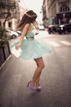 Dancing in the street! Love those lavender pumps!