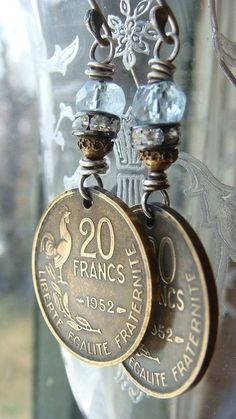 Repurposed Vintage 1952 French Brass Coin and Aquamarine Earrings Cobwebpalace - Remember to bring home coins because this would be a fun way to remember a special trip! Coin Jewelry, Wire Jewelry, Jewelry Crafts, Jewelry Art, Beaded Jewelry, Vintage Jewelry, Handmade Jewelry, Jewelry Design, Jewellery