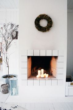 Pillar candles | 15 Ways to Decorate Your Non-Working Fireplace