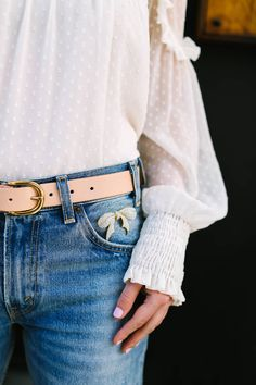 Rhinestone Bow Brooch on Denim Jean Pocket from Sweet & Spark. Click through to shop our modern, one-of-a-kind, vintage brooch collection now!