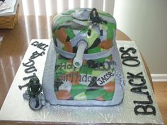 """Call of Duty: Black Ops Tank Birthday Cake - This is a birthday cake I made for a 10 year old boy who had a Call of Duty themed party. The top cake was a 9"""" trimmed to around 8"""" yellow round cake w/vanilla bc filling. The bottom cake was a 9X13"""" choc. cake w/choc. bc filling. I decorated it with MMF and a little vanilla bc. The army guys are positionable toys I found online. A wide plastic straw was covered in mmf for the firing gun--which my husband helped me out by doing--I think he ..."""