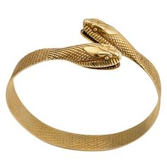 The wearer of this gold hypnotic snake bracelet, circa will receive the serpent's historically proclaimed ability to promote fertility, life and healing. Fox Jewelry, Snake Jewelry, Art Deco Jewelry, Animal Jewelry, Jewellery, Ancient Jewelry, Antique Jewelry, Vintage Jewelry, Antique Bracelets