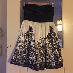 Satiny cocktail dress Worn once or twice. Perfect condition, super classy and cute! Size 1 but has some give to it. Black part is stretchy material Trixxi Dresses Mini