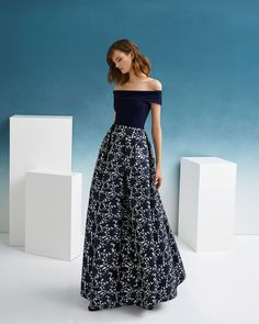 cdb6d5a51067 Classic cocktail dress in brocade and crepe. Off-the-shoulder neckline.  2019 FIESTA AIRE BARCELONA Collection.