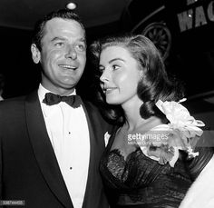 Gig Young and Elaine Stewart attend the premire of 'The Egyptian' in Los Angeles,CA. August 12, 1953