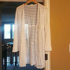 White Cover Up Hard to describe, but it's like a cute see through long sleeve jacket/cover up. Can be worn over a cami with some jeans and boots. It's like a long sweater, but see through...if that makes sense. 97% Nylon, 3% Spandex Brand new, New with tags (NWT) never worn, super cute! Ships immediately, bundle with some camis I have listed and save Jantzen Tops Tunics