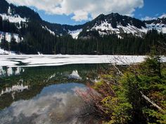 Annette Lake sporting snow and vivid greenery. Photo by John Brink.