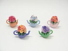 Miniature polymer clay teapots by Fizzyclaret