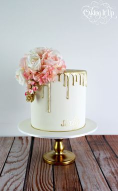Classy and elegant golden drizzle 60th birthday cake with a pretty posy of blooms and hand painted sixy. www.facebook.com/cakingitup