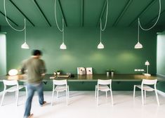 Contrasting green and white ceilings and walls feature throughout this office…