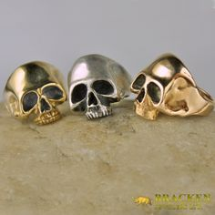 Skulls have been featured in jewelry and artwork since the earliest creations. The house of Bracken masters ancient and traditional designs, using both to create the looks of today. This is our contribution to the skull movement of the 21st century. -TB  Featured Here (Left to Right) 18K Yellow Gold, .925 Sterling Silver, 18K Rose gold