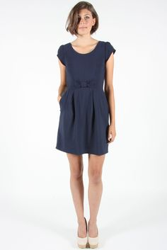 """Turca is a sweet, everyday dress with capped sleeves, front pockets and a bow detail at the front waist. It is made of beautiful drapey viscose, has an invisible back zipper, and is fully lined. Shoulder to hem 35.5"""".   • 100% Viscose. • Made in Canada."""