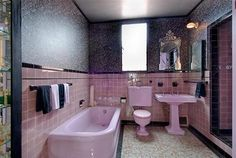 Inspiration for: Vintage pink bathroom preserved & updated with brushed steel, & pewter accents.