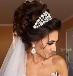 Curly Wedding Updo With Tiara And Veil