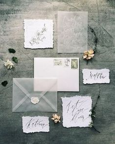Hand Lettered Wedding Invitation Inspiration | Vellum envelopes stole the show for this gray wedding invitation suite. The bride used paper with rough edges and a white wax seal for a look that is unique and elegant. With a detail like this, guests will be impressed with your eclectic choice in wedding invitations.