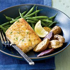 Using a bit of salt to season the fish and a little more to boost the pan sauce heightens flavors without going overboard in sodium. A little lemon juice and fresh parsley round out flavors. Serve with haricots verts and fingerling potatoes to complete the meal. For another flavor boost, serve with fresh lemon wedges.