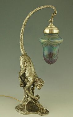 Art Nouveau Silvered Table Lamp with Monkey and Loetz Glass | From a unique collection of antique and modern table lamps at https://www.1stdibs.com/furniture/lighting/table-lamps/