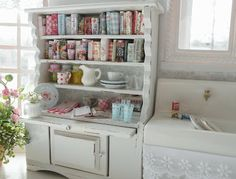 Love the cookbook display and cabinet and farmhouse sink...this is from a miniature house!