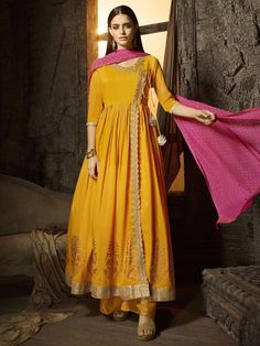Enhance Your Wardrobe With This Vibrant Yellow and Pink Coloured Muslin Embroidered Sharara Suit features zari resham work on the yoke and foil print. This Sharara Style Paired with muslin foil print palazzo and chiffon foil print dupatta. Designer Kurtis, Designer Dresses, Indian Dresses, Indian Outfits, Pakistani Outfits, Cotton Anarkali, Anarkali Suits, Sharara Suit, Anarkali Dress