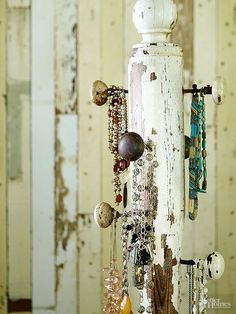 A weathered porch post and flea market doorknobs make a one-of-a-kind jewelry holder with vintage style. Fasten old-fashioned doorknobs at varying heights to provide the perfect space for necklaces and bracelets to hang./