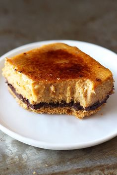 Creme Brule Pumpkin Chocolate Cheesecake Bars - OH MY GOD these are incredible. No exaggeration.